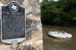 A plaque marks the historical site of the round rock in Brushy Creek for which the city was named.