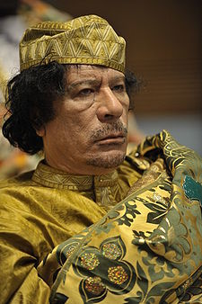 The attack ads feature images of former political figures such as Libyan leader Muammar Gaddafi.