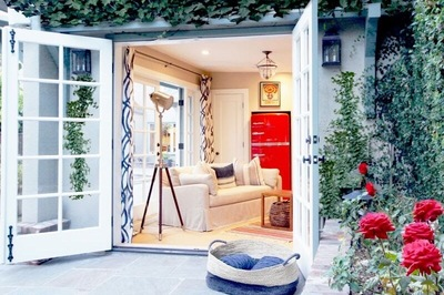 A red refrigerator in this pool house mirrors the beautiful red roses that are always blooming outside.