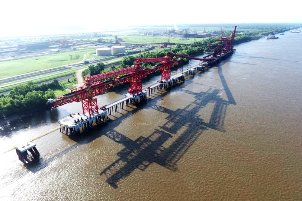 The agreement allows barge unloading at Convent Marine Terminal with the assistance of Cooper's stevedoring and barge services.
