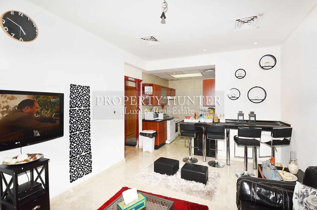Living space in an available fully furnished two bedroom apartment in Zig Zag Towers