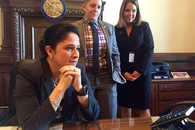 Illinios Comptroller Susana Mendoza, left, with members of her staff, watching last November as the State Senate overrode Gov. Bruce Rauner's veto of the Debt Transparency Act, which resulted in her office's first debt transparency report last month.