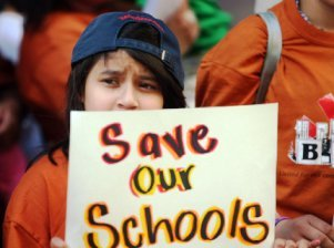 Save our schools sign girl