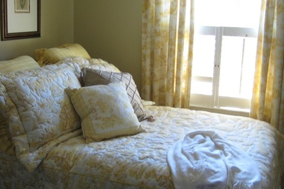 Quilts lend a look and feel of comfort in a bedroom setting.