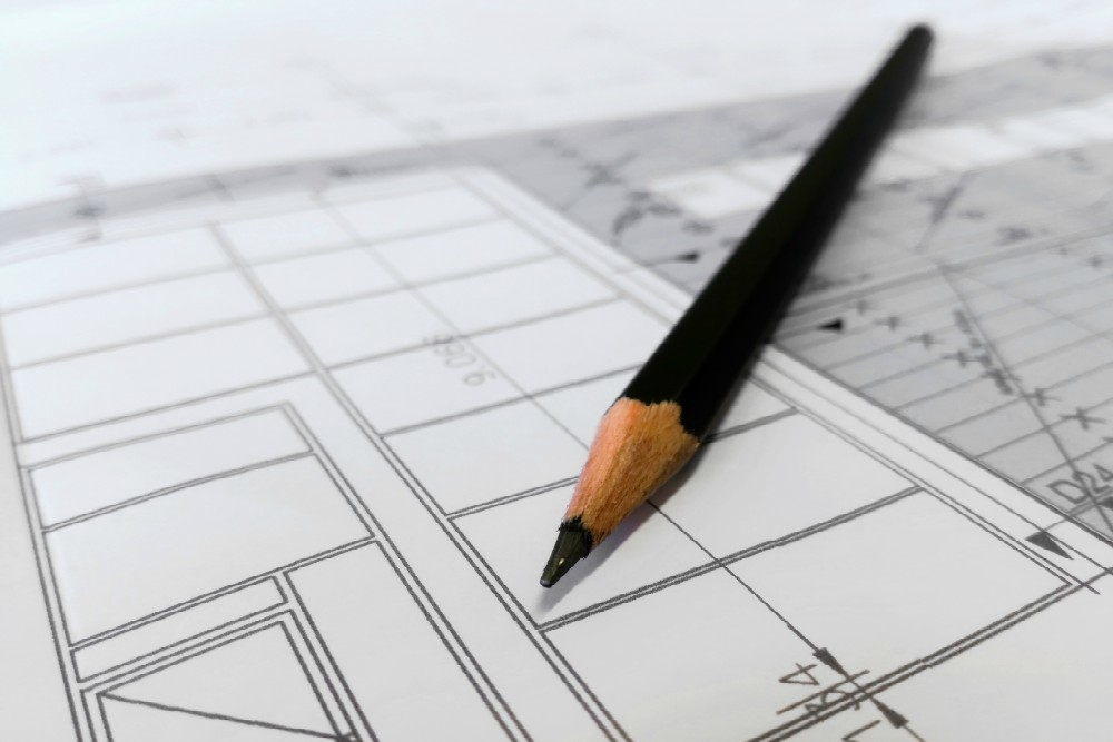 Lauren Ortega and Chris Poitier's responsibilities involve overseeing various aspects of building and site development.