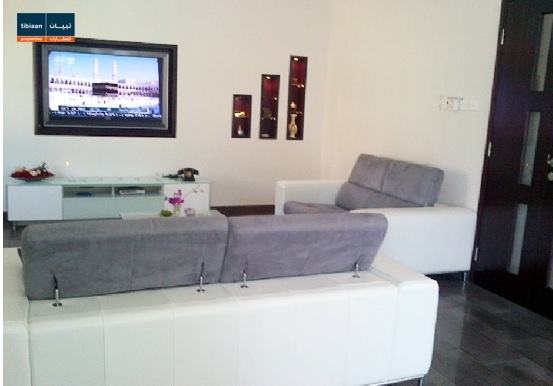 Living space in the availabel four bedroom villa in Al-Qurum