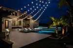 Using numerous small light sources instead of one large one creates a soft glow over a large outdoor area.