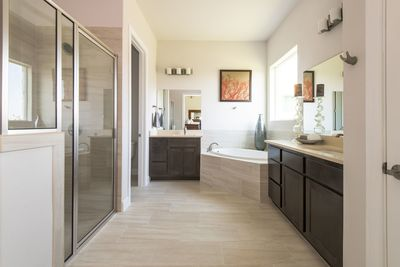 The master bath is elegant and beyond comfortable.
