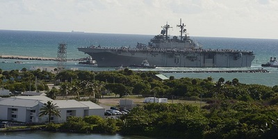 A worker says his employers were negligent during a ship moving incident at Port Everglades. The USS Wasp at Port Everglades is pictured.