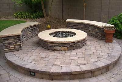 Many people are choosing concrete seating around their fire pit.