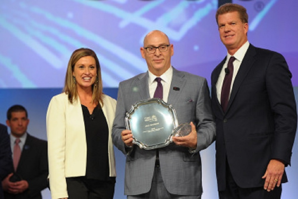 Jack Salzman, center, owner of Lake Norman Chrysler, was named 2018 Time Dealer of the Year.