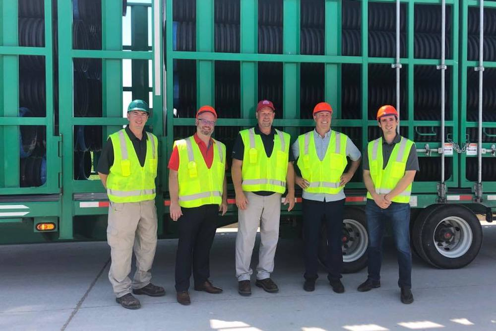 Second to the left, State Rep. Jeff Keicher visits ADS plant in Mendota