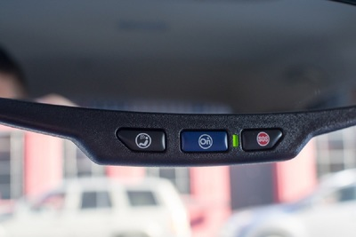 On General Motors vehicles, 911 is accessed through OnStar buttons.