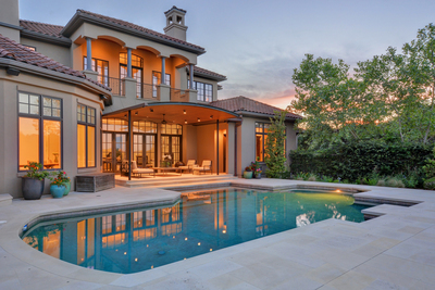 The gated estate home in Davenport Ranch Estate features a sparkling pool and a private guest apartment.