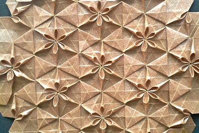 Paper art designs in either abstract or geometric patterns can give texture to a room without much visual interference.