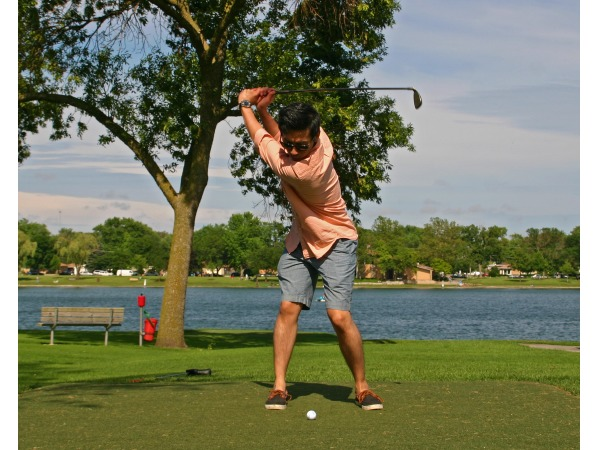 A golfer loads up a swing at Lake Park Golf Course