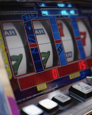 California Attorney General Kamala Harris said Friday that Capital Sweepstakes Systems will pay $700,000 in penalties for allegedly targeting low income communities with illegal slot machine gaming.
