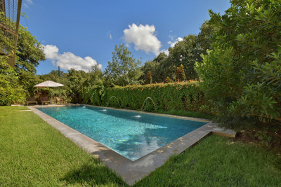 The private outdoor area features a beautiful pool and landscape lighting.