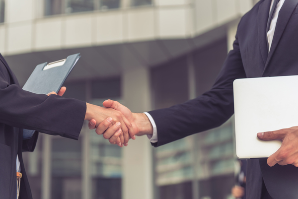 Lawyers shake hands after a meeting