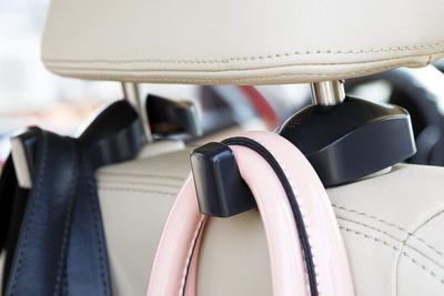 These simple plastic hooks attached to a car seat and can come in quite handy for holding bags in transit.