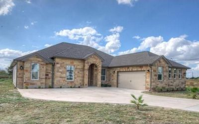 This stunning home sits on a 1.01-acre lot in Del Valle.