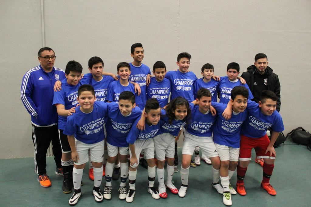 Winners of the 2017 youth indoor soccer league poses after their championship win.