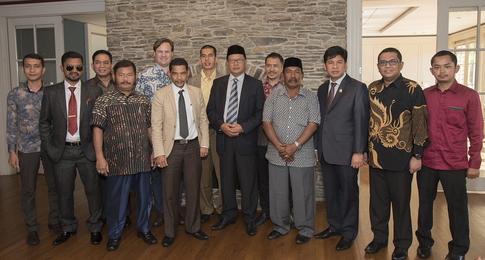 Indonesian officials from the country's Aceh Province gather in the Alumni Center at the University of Rhode Island.