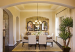 Subtle details like lighting and plant fixtures add elegance to a room.