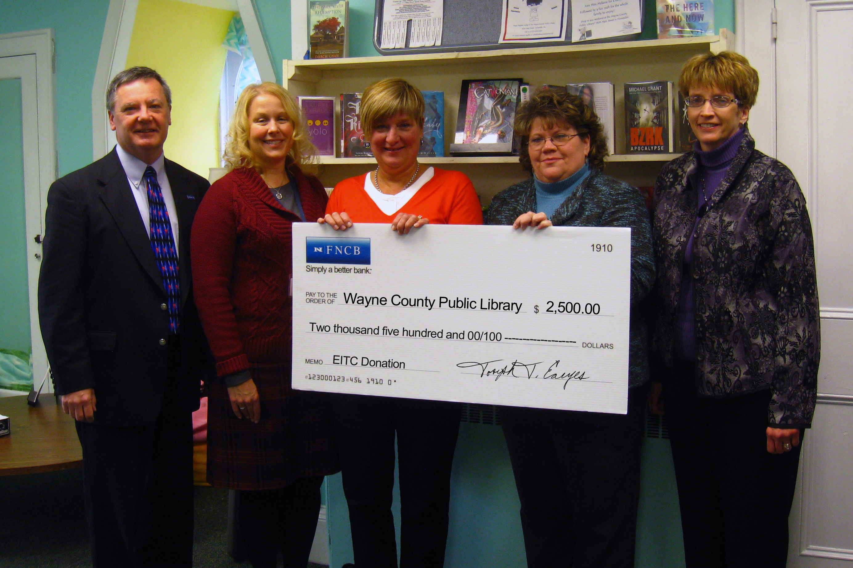 FNCB officials present a $2,500 Educational Improvement Tax Credit donation to the Wayne County Public Library. The donation will help fund programs for K-12 students in Western Wayne, Wayne Highlands and Wallenpaupack-area schools.