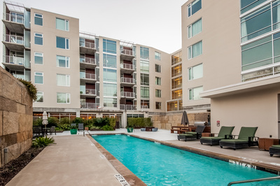 A large pool is just one of the many amenities at the Bridges on the Park condominium complex in Austin.