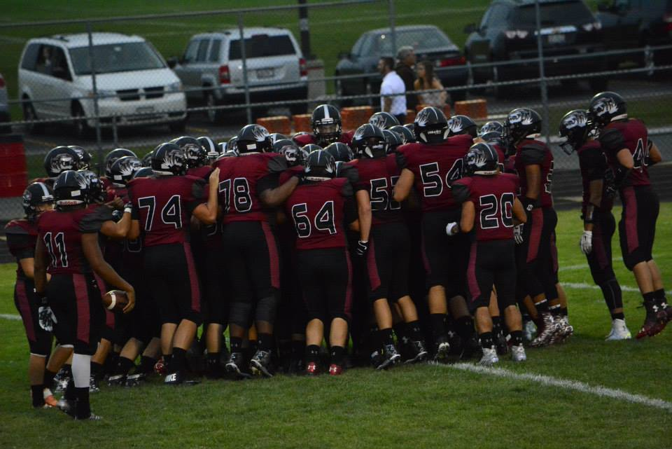 The Plainfield North High School football team huddles during a game last season