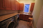 A counter above a front-loading washer and dryer is a great place to fold clothes.