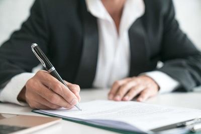 Medium man signing contract close up deal concept 894443420