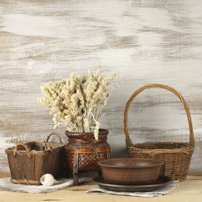 A wide variety of items can be used to create a shabby chic look, including baskets, dried flowers, old bowls and vintage place mats.