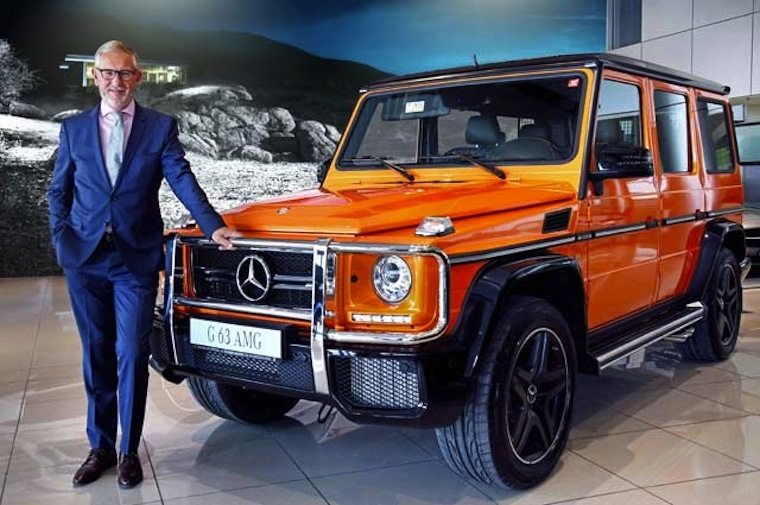 Gargash Enterprises General Manager Karl-Johan Sandesjo stands in front of a car sold by his company.