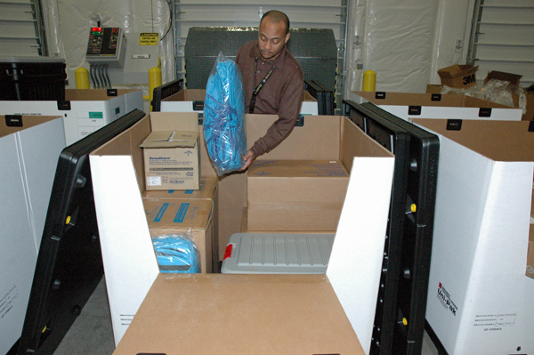 CDC personnel are assembling product from the Strategic National Stockpile into individual personal protective equipment kits, each of which can be used to care for one Ebola patient for up to five days.