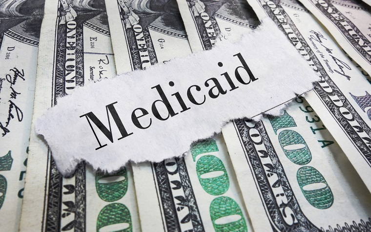 New Medicaid enrollments have been costing much more than originally expected, an expert believes.