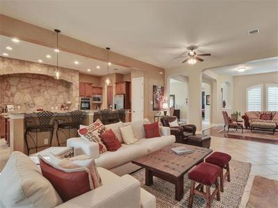 The open-concept layout allows the living and family rooms to flow right into the gourmet kitchen.
