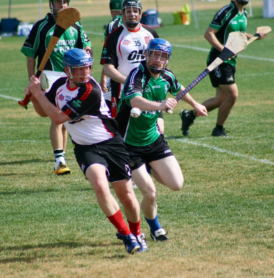 A member of the Naperville Hurling Club prepares to hit the ball during a game.
