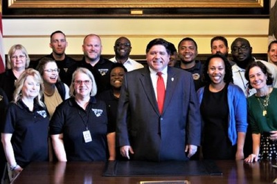 ​Gov. J.B. Pritzker last week with Illinois Department of Juvenile Justice educators, security and program staff and youth