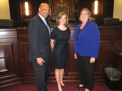 Michelle Kichline, center, with fellow county commissioners, Kathi Cozzone and Terence Farrell