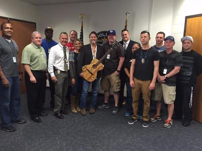 Austin police recently recovered a stolen guitar owned by musician Walt Wilkins (center, holding guitar).