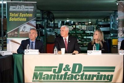 Vice President Mike Pence, center, with U.S. Department of Agriculture Deputy Secretary Stephen Censky and J&D Manufacturing Owner and President Tracy Trippler in Eau Claire last week.