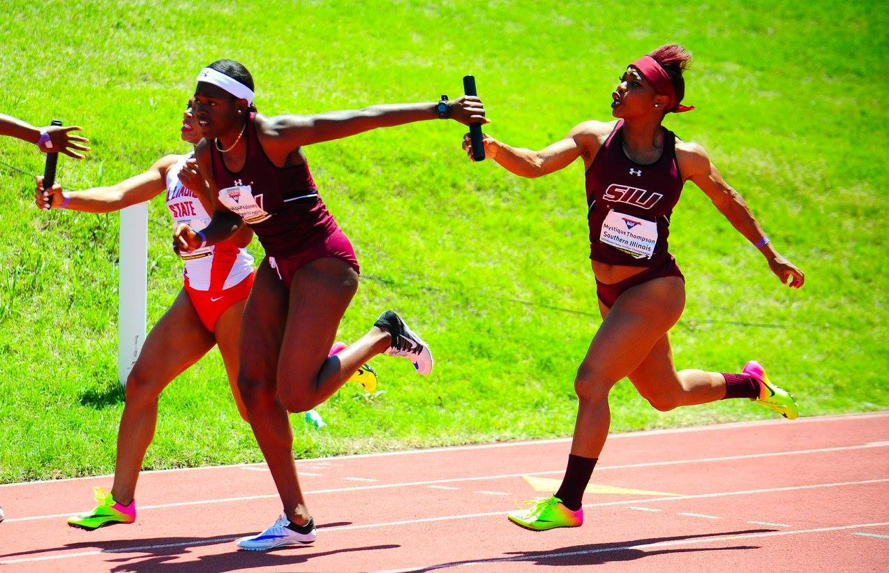 Members of SIU's women's track team compete in a relay race last year.