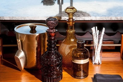 Decanters and other antique bar items are fun for accessorizing.