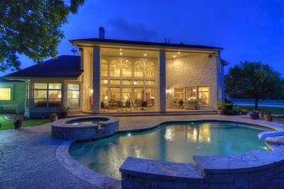 The spa-like pool area includes a covered entertaining area.