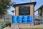 Noah Smith, of Boy Scout Troop 256, planned, developed and provided leadership to construct the 220-gallon rainwater collection system as well as a rainwater cycle story board for a school project. The entire project is used by students every day and is a