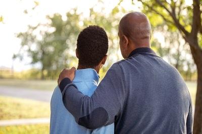 Medium a father having his arm around his son