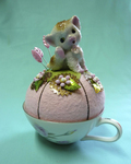 Stitch Lab owner Leslie Bonnell repurposes old teacups and figurines to make keepsake pin cushions.