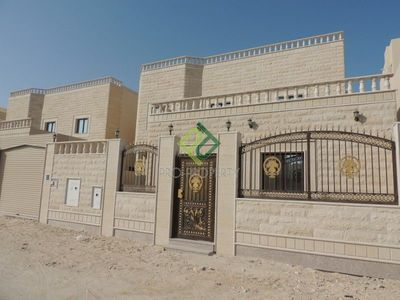 The exterior of an available 5-bedroom villa in Umm Salal Ali.